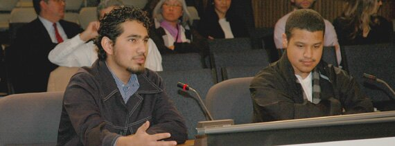 Alvin Ramirez (left) and Jeffrey Flores (right) testify at the Commission on Hispanic Legal Rights and Responsibilities hearing in San Francisco.